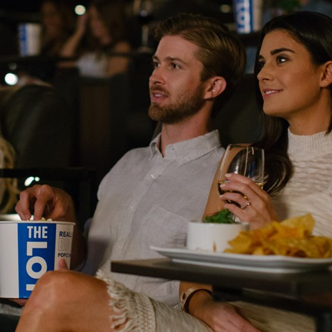 Couples watching a movie at THE LOT at Fashion Island in Newport Beach